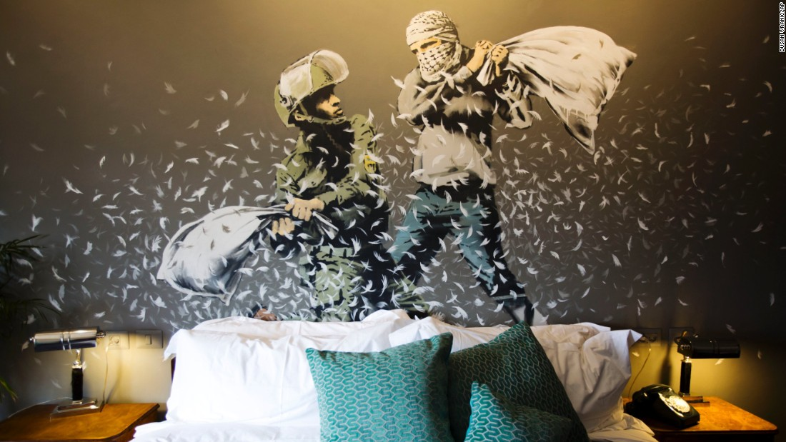 "Each room is different and features a variety of artwork including this wall mural by Banksy.  According to the hotel's website, the aim of the hotel is ""to tell the story of the wall from every side and give visitors the opportunity to discover it for themselves."""