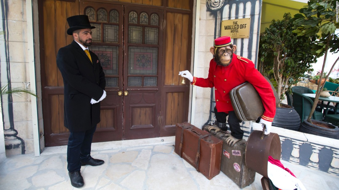 The establishment is operated by the local community. Here, a doorman stands at the entrance of the hotel.