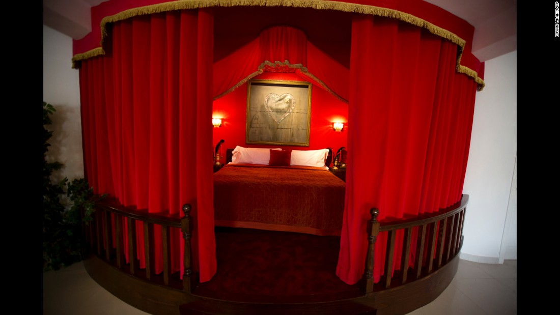 "The presidential suite features a striking feature bed and is, according to the website, ""equipped with everything a corrupt head of state would need."""
