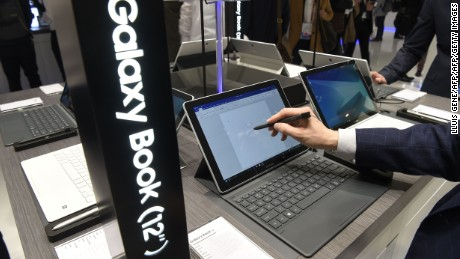 A visitors tries the Galaxy Book at the stand of Samsung on the first day of the Mobile World Congress in Barcelonaon on February 27, 2017 in Barcelona. Phone makers will seek to seduce new buyers with artificial intelligence functions and other innovations at the world's biggest mobile fair starting today in Spain.   / AFP / LLUIS GENE        (Photo credit should read LLUIS GENE/AFP/Getty Images)