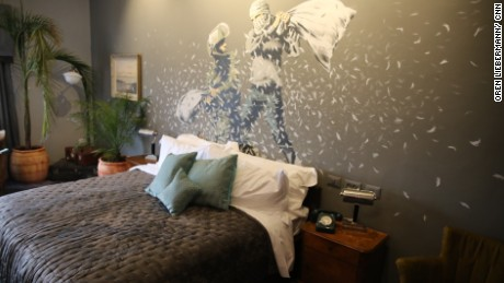 A Banksy wall mural in one of the guest rooms of the hotel
