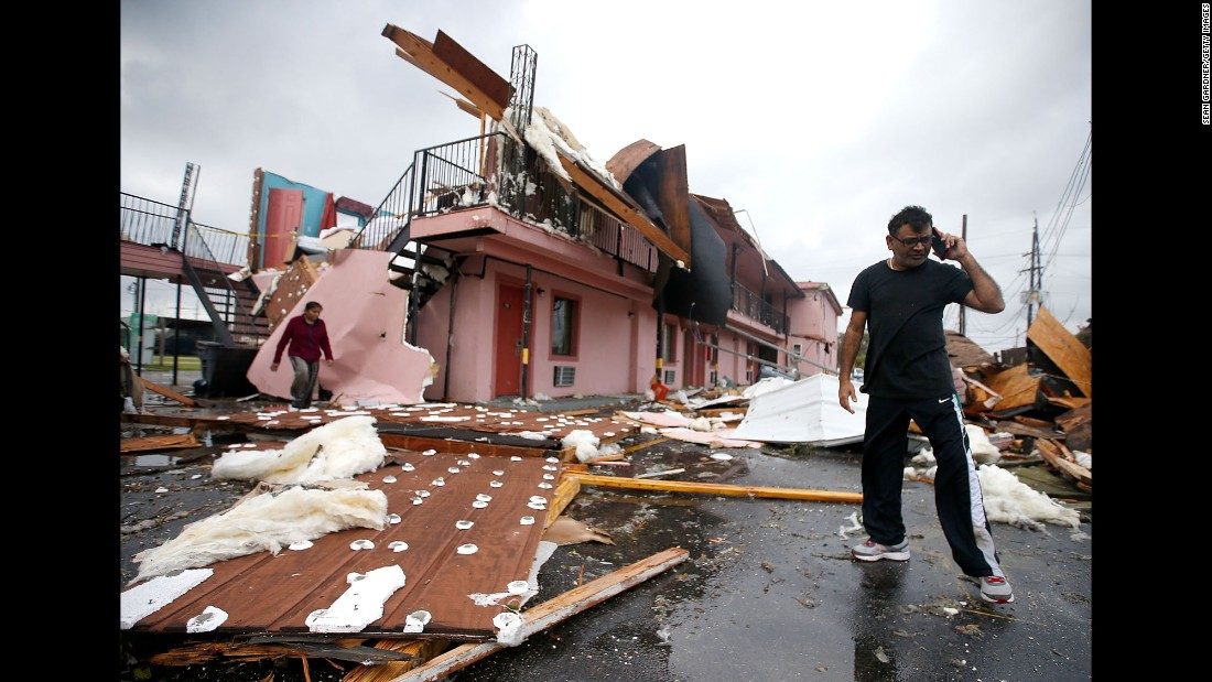 "A man walks through the debris of what once was a motel in New Orleans on Tuesday, February 7. <a href=""http://www.cnn.com/2017/02/07/us/gallery/tornado-new-orleans-0207/index.html"" target=""_blank"">A tornado hit east New Orleans</a> earlier in the day."