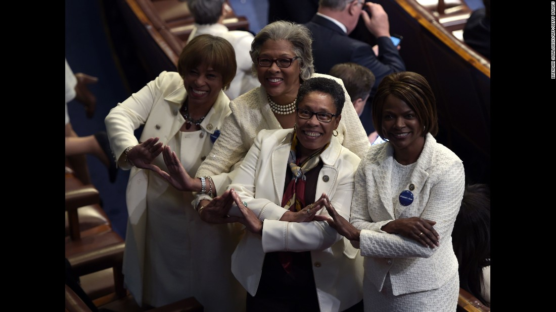 "From left, US Reps. Brenda Lawrence, Joyce Beatty, Marcia Fudge and Val Demings pose for a photo before Trump's address to Congress on Tuesday, February 27. Many Democrats wore white as a nod to <a href=""http://www.cnn.com/2016/08/18/politics/gallery/tbt-womens-suffrage/index.html"" target=""_blank"">the women's suffrage movement.</a>"