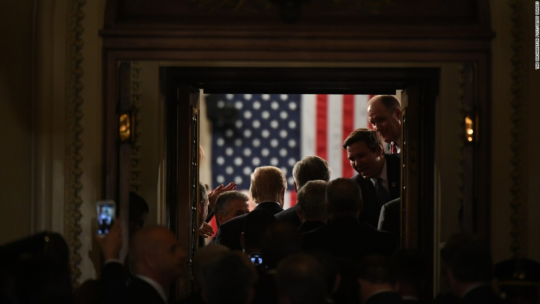 "President Trump stands in the doorway of the House chamber while being introduced for his speech to Congress. <a href=""http://www.cnn.com/2017/02/25/politics/gallery/week-in-politics-0226/index.html"" target=""_blank"">See last week in politics</a>"