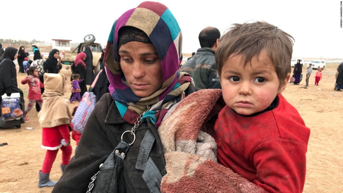 A woman from western Mosul carries her child and the few possessions she could gather before escaping the city. By Saturday, the Iraqi government estimated that nearly 50,000 people had fled western Mosul to government-controlled territory. Most ended up in refugee camps hastily set up by the government and local and international relief groups.