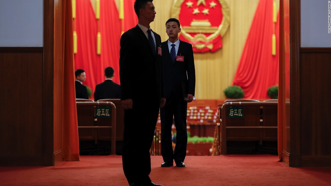 Chinese armed police stand guard inside the Great Hall of the People before the opening session.