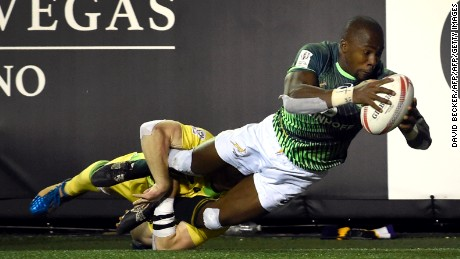 Siviwe Soyizwapi of South Africa dives for a try as Henry Hutchison of Australia holds on during day two of the USA Sevens Rugby tournament, part of the World Rugby Sevens Series, March 4, 2017 in Las Vegas, Nevada.  / AFP PHOTO / David Becker        (Photo credit should read DAVID BECKER/AFP/Getty Images)