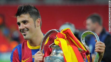 Barcelona's Spanish forward David Villa celebrates with the trophy at the end of the UEFA Champions League final football match FC Barcelona vs. Manchester United, on May 28, 2011 at Wembley stadium in London.Barcelona won 3 to 1. AFP PHOTO / LLUIS GENE (Photo credit should read LLUIS GENE/AFP/Getty Images)