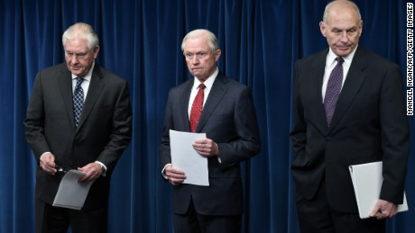"(L-R) US Secretary of State Rex Tillerson, Attorney General Jeff Sessions, and Homeland Security Secretary John Kelly arrive to deliver remarks on visa travel at the US Customs and Border Protection Press Room in the Reagan Building on March 6, 2017 in Washington, DC. US President Donald Trump signed a revised ban on travelers from six Muslim-majority nations Monday -- one with a reduced scope so Iraqis and permanent US residents are exempt. The White House said Trump signed the order -- which temporarily freezes new visas for Syrians, Iranians, Libyans, Somalis, Yemenis and Sudanese citizens -- behind closed doors ""this morning"".  / AFP PHOTO / MANDEL NGAN        (Photo credit should read MANDEL NGAN/AFP/Getty Images)"