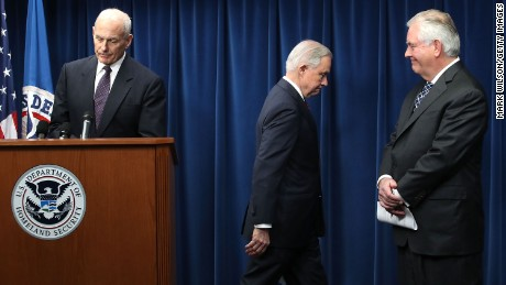 WASHINGTON, DC - MARCH 06:  Secretary of Homeland Security John Kelly (L), Secretary of State Rex Tillerson (R) and Attorney General Jeff Sessions take turns offering brief remarks related to a reconstituted travel ban at a news conference at the U.S. Customs and Borders Protection headquarters on March 6, 2017 in Washington, DC. (Photo by Mark Wilson/Getty Images)