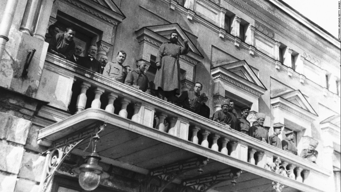 Russian revolutionists stand on the balcony of the Tsar's residence near Petrograd.