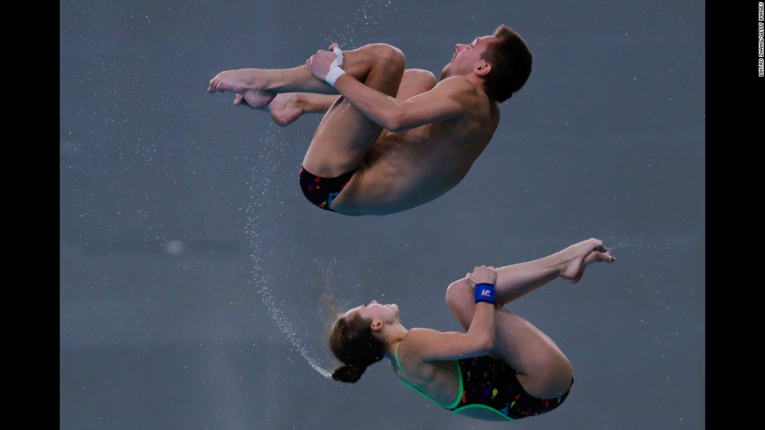 Yulia Timoshinina and Viktor Minibaev, synchronized divers from Russia, compete during the Diving World Series event in Beijing on Sunday, March 5. They finished second in the 10-meter platform.