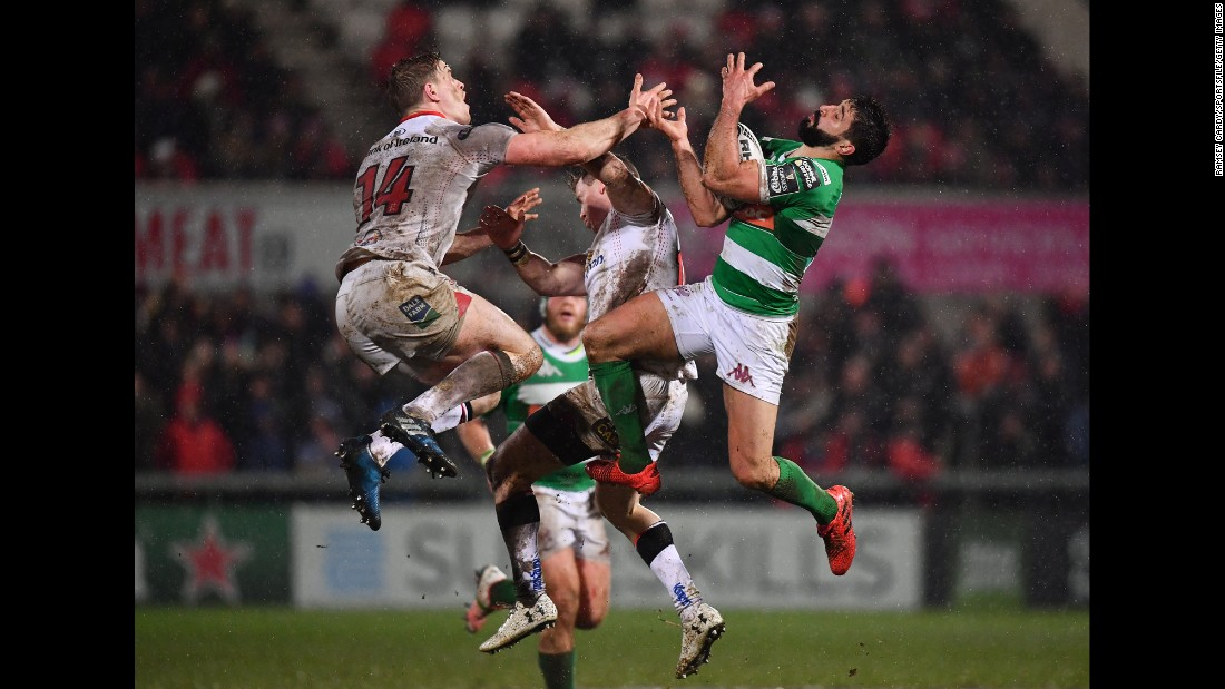 Ulster's Andrew Trimble, left, jumps near Benetton Treviso's Tito Tebaldi during a Pro12 rugby match in Belfast, Northern Ireland, on Friday, March 3.