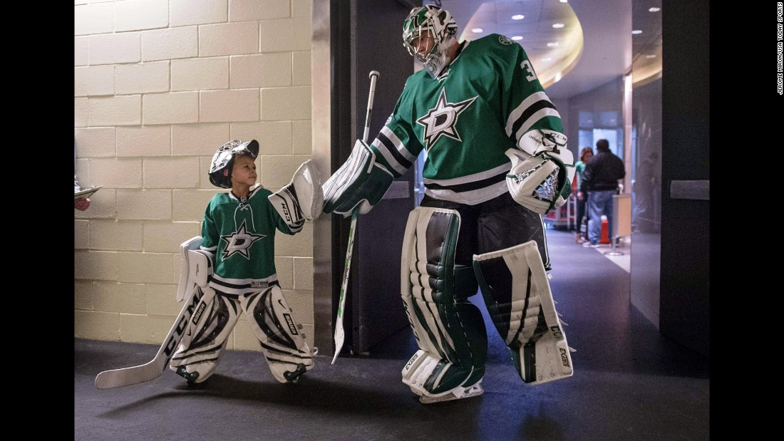 Dallas goalie Kari Lehtonen greets 6-year-old Zavier Green before an NHL hockey game on Thursday, March 2.
