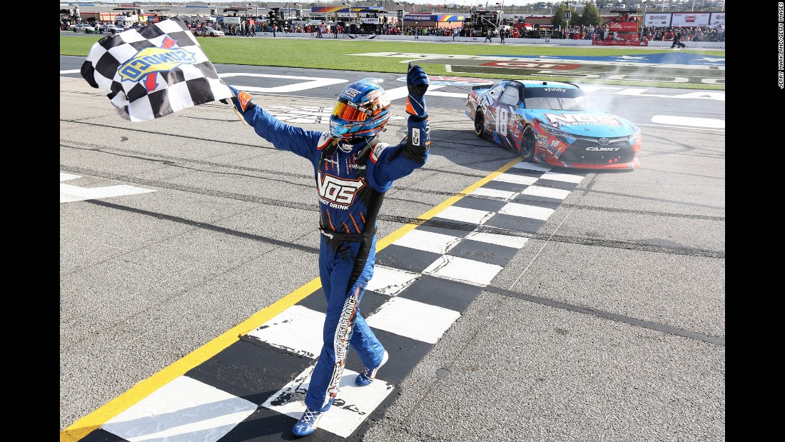 NASCAR driver Kyle Busch celebrates with the checkered flag Saturday, March 4, after winning the Xfinity Series race at Atlanta Motor Speedway.