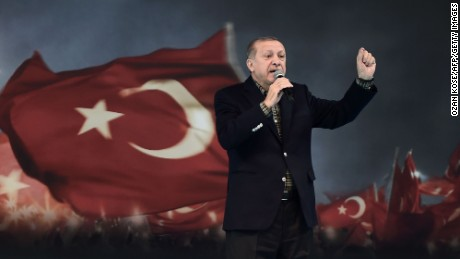 "Turkish President Recep Tayyip Erdogan gestures as he delivers a speech on stage, on March 5, 2017 in Istanbul during a pro-government women meeting. Some 12,000 women filled on March 5 an Istanbul arena in support of a ""Yes"" vote in an April referendum whether to boost Turkish President Recep Tayyip Erdogan's powers. Erdogan lashed out at Germany for blocking several rallies there ahead of an April vote in Turkey on boosting his powers as head of state, likening them to Nazi practices. ""Your practices are not different from the Nazi practices of the past,"" Erdogan told a women's rally in Istanbul as Turks vote on April 16 whether to approve changes to the constitution expanding presidential powers.  / AFP PHOTO / OZAN KOSE        (Photo credit should read OZAN KOSE/AFP/Getty Images)"
