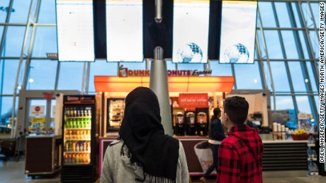 NEW YORK, NY - MARCH 6: A young woman wearing a Hijab watches the arrivals board at the international terminal at John F. Kennedy International Airport, March 6, 2017 in New York City. President Donald Trump signed a new executive order on Monday that will ban travelers from six majority-Muslim nations from entering the United States for 90 days. (Photo by Drew Angerer/Getty Images)
