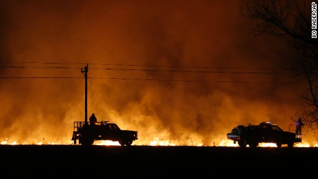 Firefighters from across Kansas and Oklahoma battle a wildfire near Protection, Kan., Monday, March 6, 2017. (Bo Rader/The Wichita Eagle via AP)