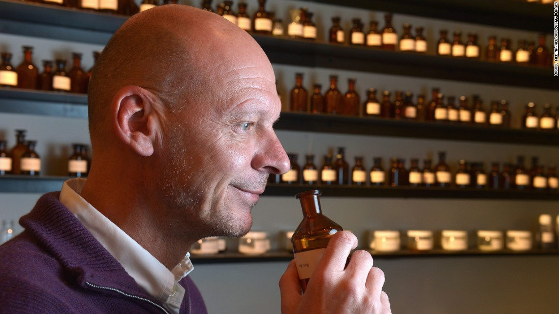 British perfumer Mark Buxton smells one of his creations at his workplace in Paris.