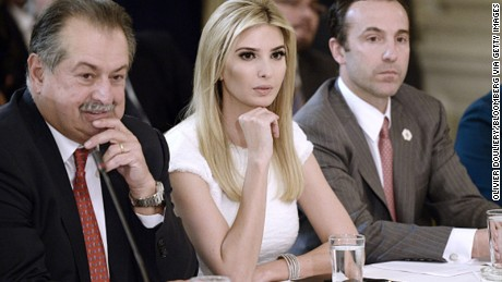 Andrew Liveris, chairman and chief executive officer of The Dow Chemical Co., from left, Ivanka Trump, and Reed Cordish, White House assistant of intragovernmental and technology initiatives, listen during a manufacturing executives meeting at the White House.