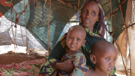 Fatuma Hassan Hussein sits with her two children Shankaron, 3, and Rahma, 15 months, in a makeshift shelter in Baidoa, Somalia. Fatuma says the family hasnÕt eaten properly in 10 days. She says she travelled more than a hundred miles to get to a camp in Baidoa, Somalia.