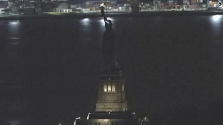 "This Tuesday, March 7, 2017, still image taken from video shows the Statue of Liberty in New York. For several hours, Lady Liberty didn't shine so brightly. The famed The Statue of Liberty was temporarily in the dark Tuesday night , March 7, 2017, after what a spokesman calls an ""unplanned outage."" (AP Photo)"