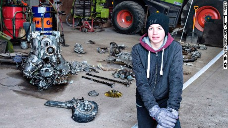 14-year-old Danish boy Daniel Rom Kristensen is photographed on March 7, 2017 in front of debris from the wreck of a World War II aircraft, which Daniel and his father Klaus Kristensen found yesterday near Birkelse by Aabybro, in Northern Jutland.  