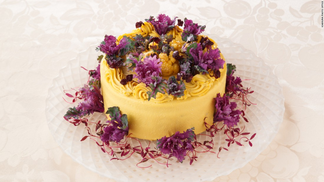 This next-level cake, flavored with pumpkin, has broccoli, cauliflower, beets and purple sweet potato inside, wrapped in yellow cauliflower, purple petit veil and amaranth sprouts.
