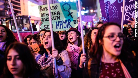 People march down Istiklal Avenue to mark International Women's Day in Istanbul on March 8.