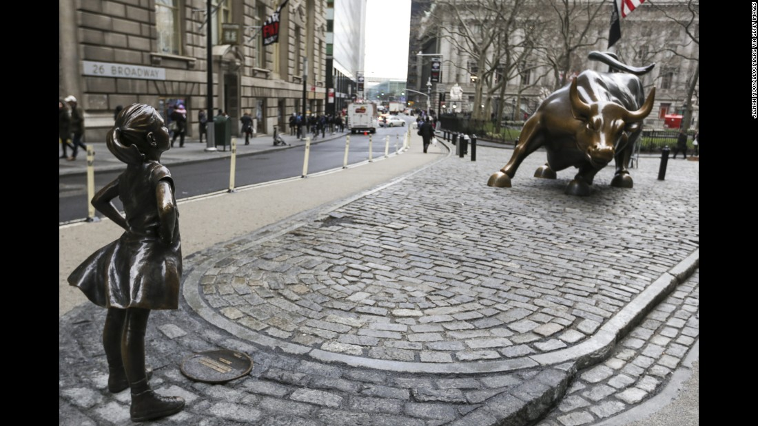 "A statue of a defiant girl faces Wall Street's charging bull sculpture in New York. ""Fearless Girl"" <a href=""http://money.cnn.com/2017/03/07/news/girl-statue-wall-street-bull/index.html"" target=""_blank"">was installed on Tuesday</a> by State Street Global Advisors. The asset manager designed it to call attention to its new initiative to increase the number of women on its clients' corporate boards."