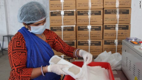 A worker loads boxes with Saathi banana fiber sanitary pads.