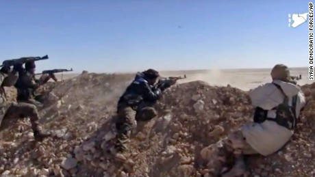 This frame grab from a video provided by the Syria Democratic Forces (SDF), shows fighters from the SDF opening fire on an Islamic State group's position, in Raqqa's eastern countryside, Syria, Monday, March 6, 2017. U.S.-backed Syrian fighters have cut the main road between the northern Syrian city of Raqqa, which is controlled by the Islamic State group, and the eastern city of Deir el-Zour, which is partially controlled by IS. The Britain-based Syrian Observatory for Human Rights says fighters from the Kurdish-led Syria Democratic Forces cut the road linking the two cities in the area of Jazra near Raqqa, the de facto capital of the IS self-declared caliphate. (Syria Democratic Forces, via AP)
