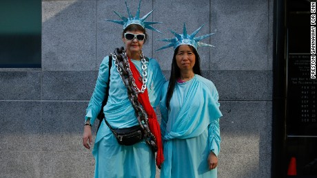"Barbara Skinner, 56, and Vi Huynh, 55, protest in San Francisco. ""I feel strongly that our liberties are at risk especially with this administration,"" Skinner said. Huynh said she came out because ""I wanted to march and rally with my sisters and allies."""