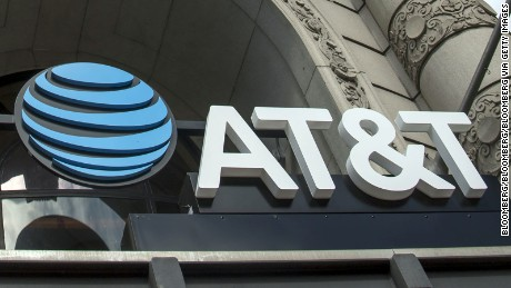 Signage is displayed outside the new AT&T Inc. flagship store in San Francisco, California, U.S., on Thursday, Sept. 15, 2016. The store will officially open to customers on September 28. Photographer: David Paul Morris/Bloomberg via Getty Images