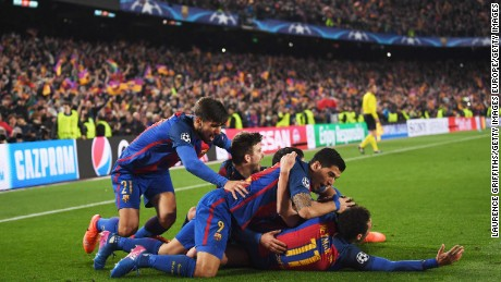 BARCELONA, SPAIN - MARCH 08:  Sergi Roberto of Barcelona (obscured) celebrates with team mates as he scores their sixth goal during the UEFA Champions League Round of 16 second leg match between FC Barcelona and Paris Saint-Germain at Camp Nou on March 8, 2017 in Barcelona, Spain.  (Photo by Laurence Griffiths/Getty Images)