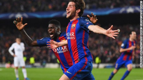 BARCELONA, SPAIN - MARCH 08:  Sergi Roberto of Barcelona (R) celebrates with Samuel Umtiti as he scores their sixth goal during the UEFA Champions League Round of 16 second leg match between FC Barcelona and Paris Saint-Germain at Camp Nou on March 8, 2017 in Barcelona, Spain.  (Photo by Laurence Griffiths/Getty Images)