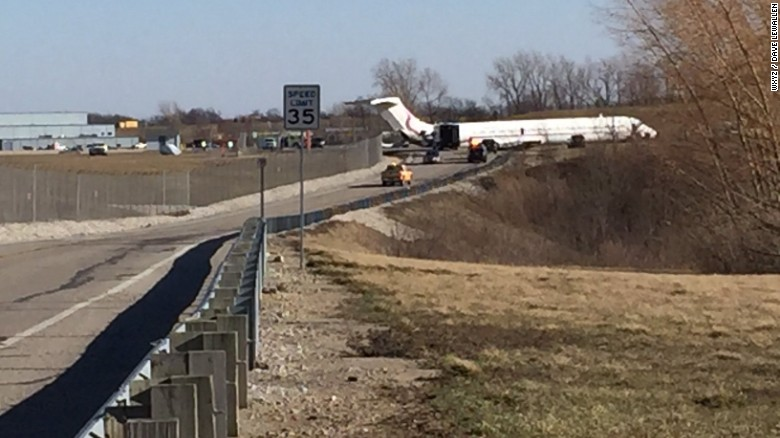 Strong winds blow team's plane off runway