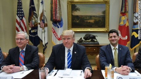 US President Donald Trump is seated for a a lunch with Republican Party House and Senate leadership, including Senate Majority Leader Mitch McConnell (L) and House Speaker Paul Ryan, in the Roosevelt Room of the White House in Washington, DC on March 1, 2017.