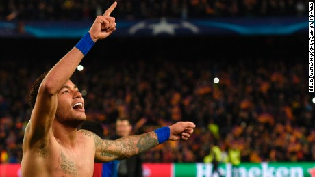 Barcelona's Brazilian forward Neymar celebrates at the end of the UEFA Champions League round of 16 second leg football match FC Barcelona vs Paris Saint-Germain FC at the Camp Nou stadium in Barcelona on March 8, 2017. / AFP PHOTO / LLUIS GENE        (Photo credit should read LLUIS GENE/AFP/Getty Images)