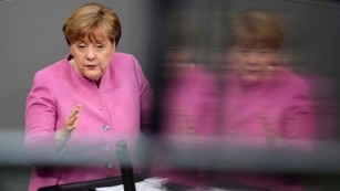 Merkel warns Turkey over democracy while urging closer ties