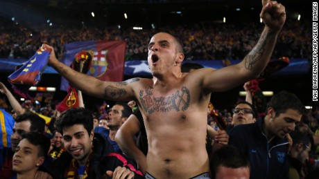FC Barcelona fans celebrate at the end of the UEFA Champions League round of 16 second leg football match FC Barcelona vs Paris Saint-Germain FC at the Camp Nou stadium in Barcelona on March 8, 2017. / AFP PHOTO / PAU BARRENA        (Photo credit should read PAU BARRENA/AFP/Getty Images)