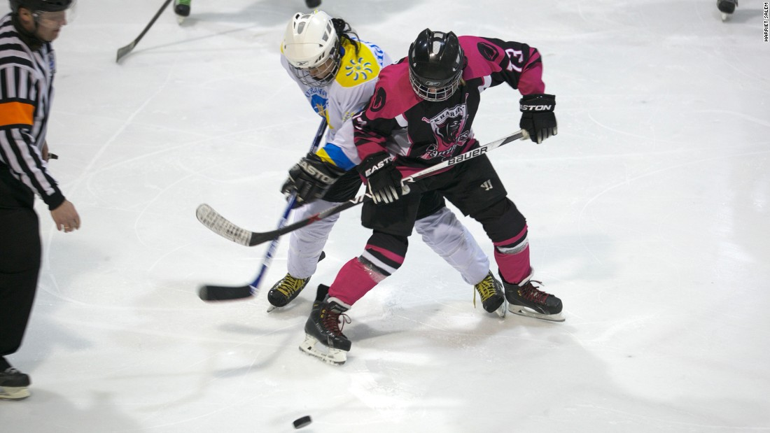 Players from Kharkiv Panthers and Kyiv Ukrainochka vie for possession.