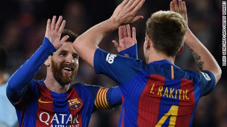 TOPSHOT - Barcelona's Croatian midfielder Ivan Rakitic (R) celebrates with Barcelona's Argentinian forward Lionel Messi after scoring a goal during the Spanish league football match FC Barcelona vs RC Celta de Vigo at the Camp Nou stadium in Barcelona on March 4, 2017. / AFP PHOTO / LLUIS GENE        (Photo credit should read LLUIS GENE/AFP/Getty Images)