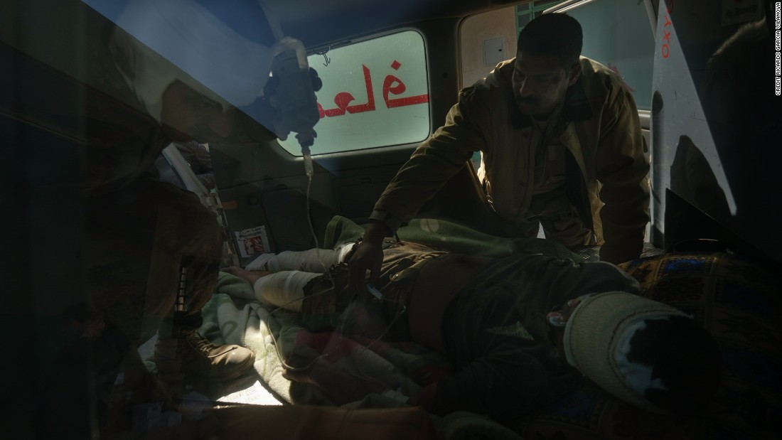 Soldiers wounded in the fight against ISIS are evacuated in an ambulance to a hospital in Mosul on the south-west front.