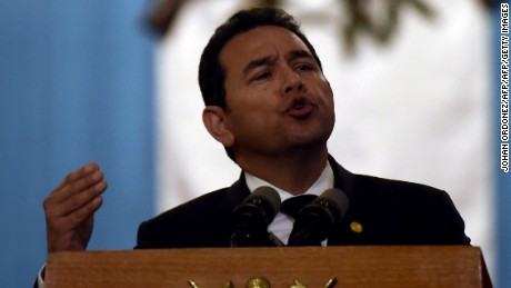 Guatemalan President Jimmy Morales speaks during a press conference at the Culture Palace in Guatemala City on March 9, 2017, where he informed about the temporary closure of the government-run children's shelter in San Jose Pinula, east of the capital where a fire took place on the eve leaving, up to now, 34 girls dead.  Guatemala recoiled in anger and shock Thursday at the deaths of 34 teenage girls in a fire at a government-run shelter where staff have been accused of sexual abuse and other mistreatment. Around 20 more survivors remained hospitalized, most of them in critical condition, according to hospital officials. / AFP PHOTO / JOHAN ORDONEZ        (Photo credit should read JOHAN ORDONEZ/AFP/Getty Images)