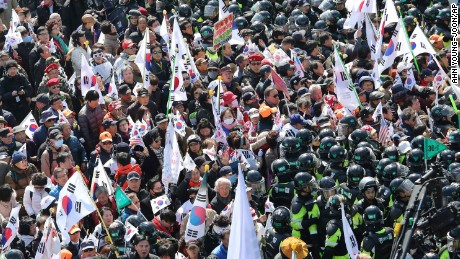 Supporters of South Korean President Park Geun-hye are blocked by police officers as they march toward the Constitutional Court.