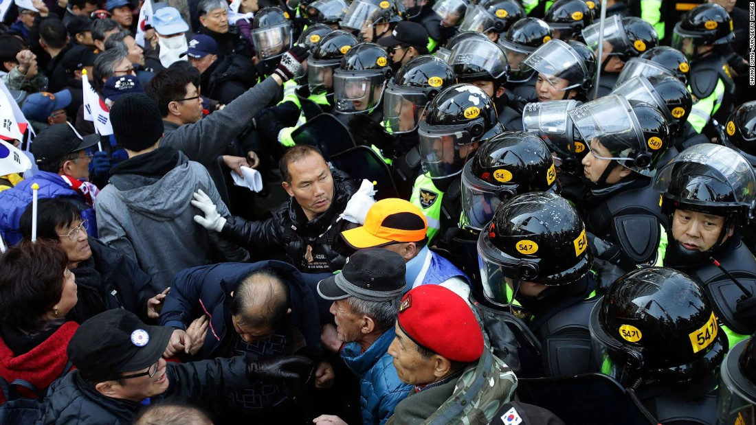 Park supporters are blocked by police during their march toward the Constitutional Court.
