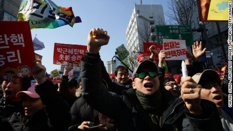 South Koreans celebrate after hearing the Constitutional Court's verdict on March 10, 2017 in Seoul, South Korea.