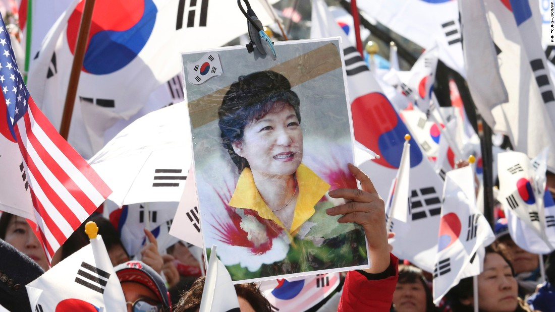 A supporter holds a portrait of Park during a rally opposing her impeachment.