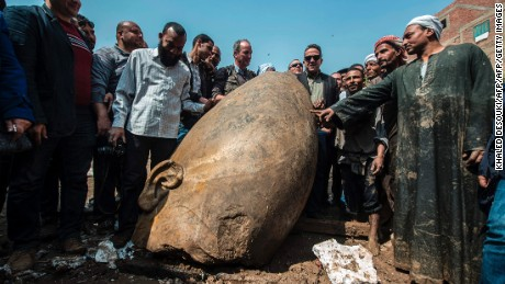Egyptian minister of antiquates Khaled el-Anani poses for picture with workers next to the head of a statue at the site of a new discovery by a team of German-Egyptian archeologists in Cairo's Mattarya district on March 9, 2017. Statues of the kings and queens of the nineteenth dynasty (1295 - 1185 BC) were unearthed in the vicinity of the Temple of Ramses II in what was the old Pharonic city.  / AFP PHOTO / KHALED DESOUKI        (Photo credit should read KHALED DESOUKI/AFP/Getty Images)